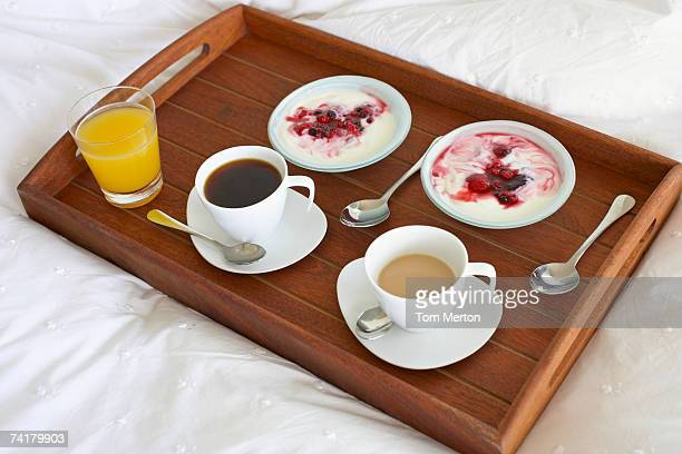 Breakfast tray with coffee and berries with cream