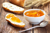 Breakfast with apricot jam and slice of bread