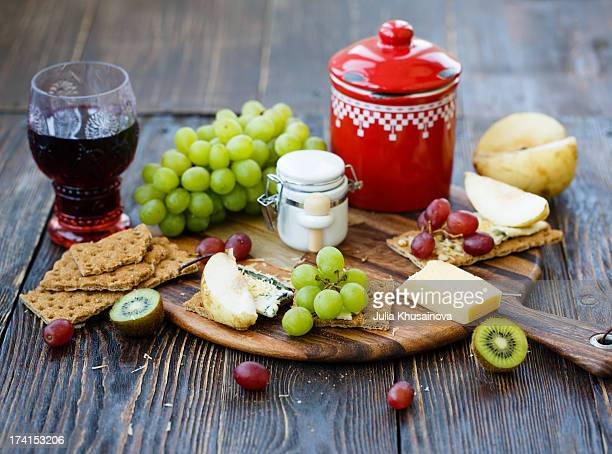 Breakfast with blue cheese, fruits and crackers