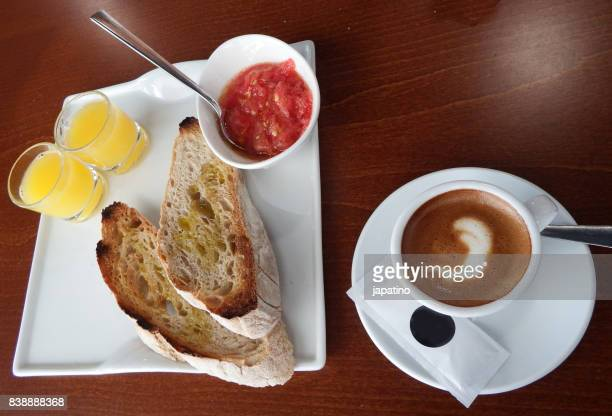 Breakfast with coffee, toast with tomato and orange juice