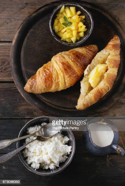 Breakfast with croissant and mango fruit