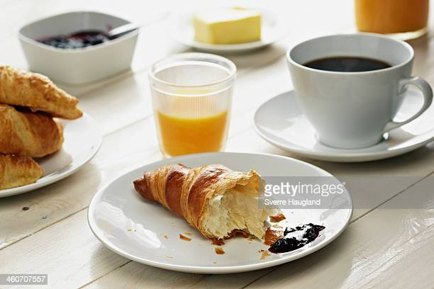Breakfast with croissant, coffee and orange juice