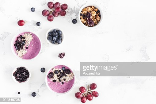 Breakfast with muesli, blueberry smoothie, fruits. Flat lay, top view : Stock Photo