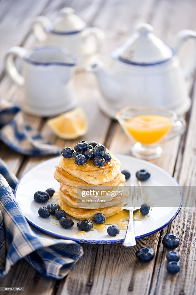Breakfast with pancakes, blueberries and honey : Stock Photo