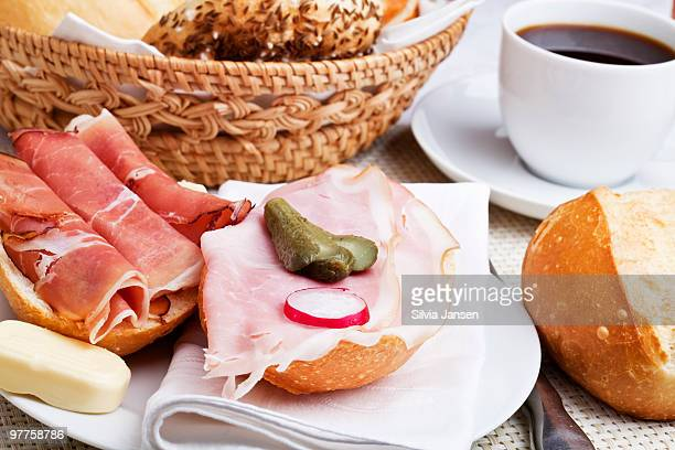 breakfast with rolls, butter and ham