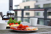 Healthy breakfast with sandwiches and coffee in french press, scandinavian style