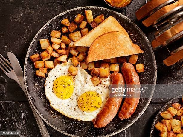 Breakfast with Sunny side up eggs and Sausage