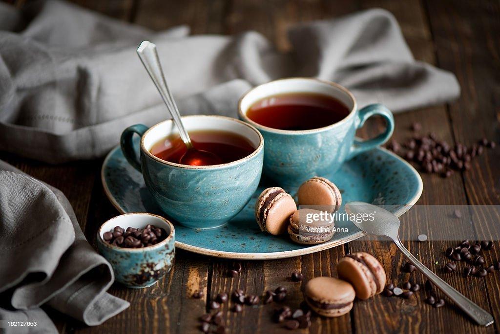 Breakfast with tea and chocolate macarons : Stock Photo