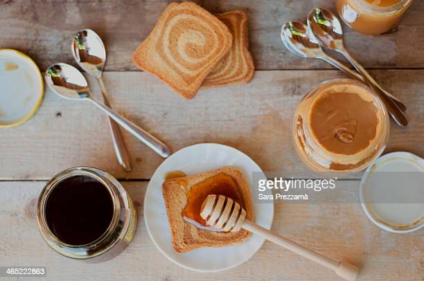 Breakfast with toast, honey and peanut butter