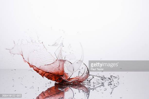 Breaking glass with red wine