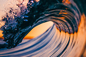 A close up with detail of a wave breaking
