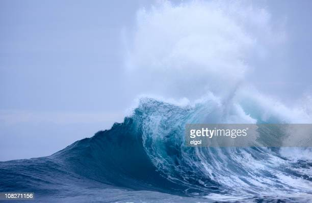 Breaking Wave with white spray and blue sky
