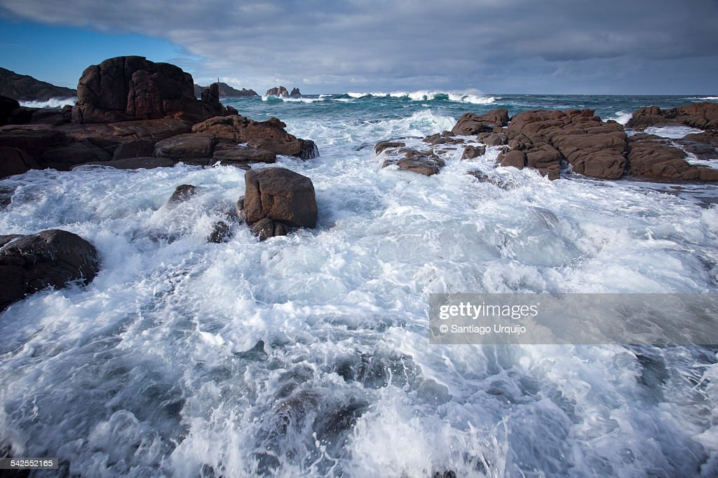 Breaking waves at the Galician rocky coastline