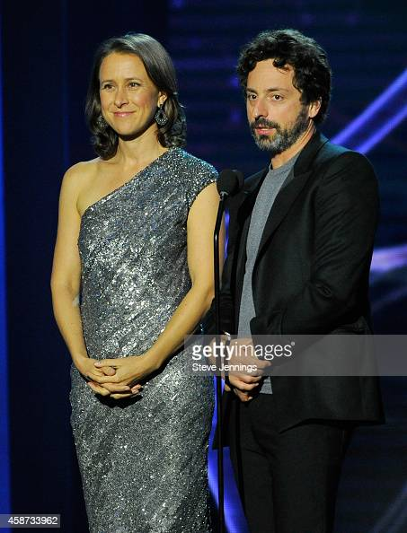 Breakthrough Prize Founders Anne Wojcicki and Sergey Brin speak onstage during the Breakthrough Prize Awards Ceremony Hosted By Seth MacFarlane at...