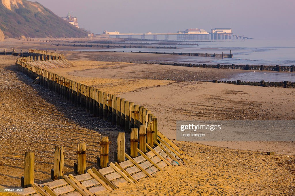 Breakwaters at Overstrand beach with Cromer pier in the distance