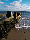 Swanage bay in Kent England, wave breaking against the breakwater sea defences