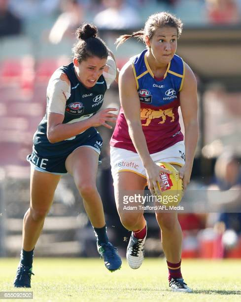 Breanna Koenen of the Lions in action ahead of Kate GillespieJones of the Blues during the 2017 AFLW Round 07 match between the Carlton Blues and the...