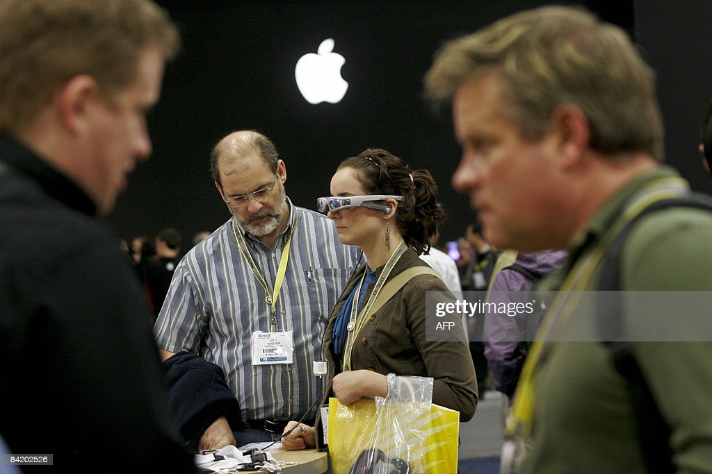 Breanna Sooter and her father Eric test out the Cinemizer video eyewear which allow users to watch movies from their iPod and iPhone during the Macworld Expo 2009 in San Francisco, CA, Wednesday, January 7, 2009. Tens of thousands of Macintosh consumers as well as Apple engineers and developers attended the annual technology fair where new Mac-compatible products were showcased along with the release of Apple's latest computer gadgets and software updates. AFP PHOTO / Ryan ANSON