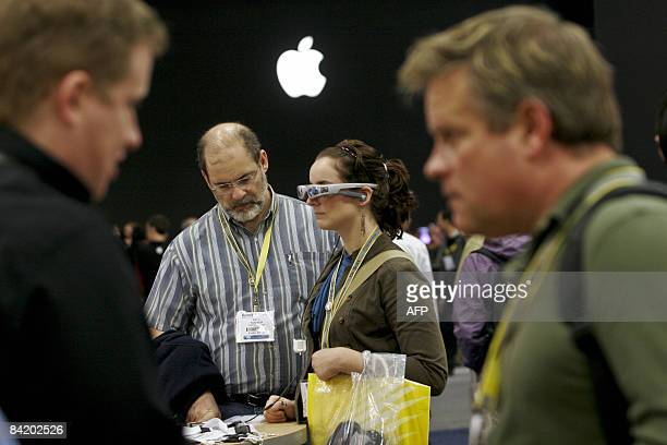 Breanna Sooter and her father Eric test out the Cinemizer video eyewear which allow users to watch movies from their iPod and iPhone during the...