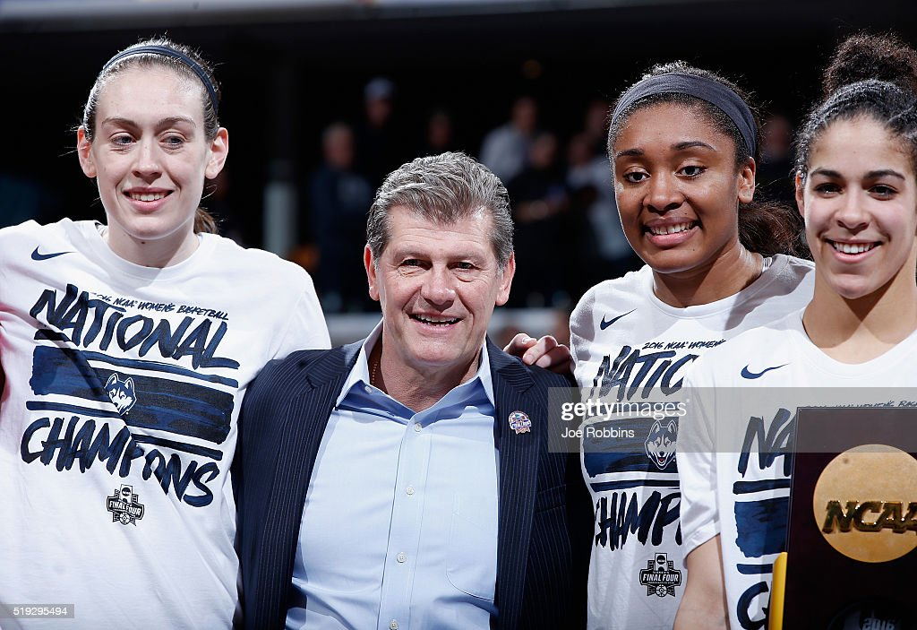 Breanna Stewart head coach Geno Auriemma Morgan Tuck and Kia Nurse of the Connecticut Huskies celebrate with the trophy after their 8251 victory over...