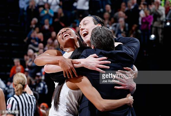 Breanna Stewart Morgan Tuck Moriah Jefferson and head coach Geno Auriemma of the Connecticut Huskies embraces as the starters take the bench in the...