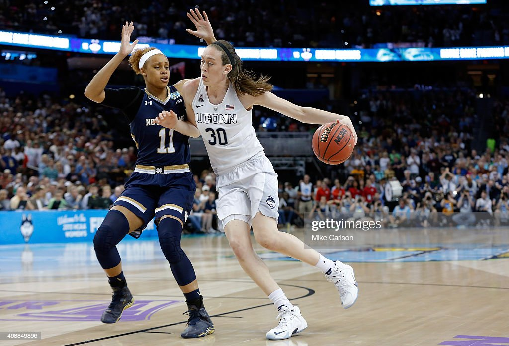 <a gi-track='captionPersonalityLinkClicked' href=/galleries/search?phrase=Breanna+Stewart&family=editorial&specificpeople=8564806 ng-click='$event.stopPropagation()'>Breanna Stewart</a> #30 of the Connecticut Huskies drives to the basket as Brianna Turner #11 of the Notre Dame Fighting Irish defends during the NCAA Women's Final Four National Championship at Amalie Arena on April 7, 2015 in Tampa, Florida.