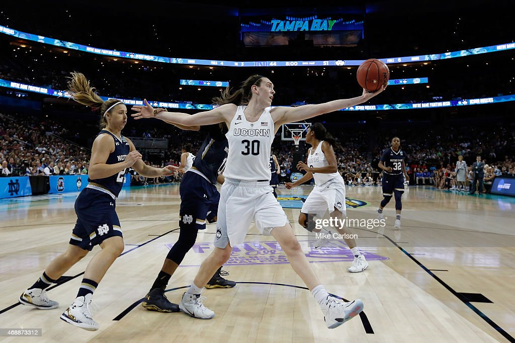 <a gi-track='captionPersonalityLinkClicked' href=/galleries/search?phrase=Breanna+Stewart&family=editorial&specificpeople=8564806 ng-click='$event.stopPropagation()'>Breanna Stewart</a> #30 of the Connecticut Huskies grabs a rebound against the Notre Dame Fighting Irish during the NCAA Women's Final Four National Championship at Amalie Arena on April 7, 2015 in Tampa, Florida.