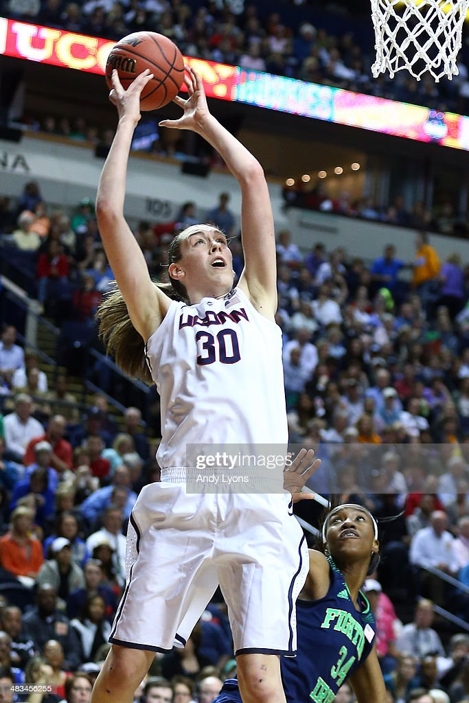 Breanna Stewart #30 of the Connecticut Huskies shoots the ball against Markisha Wright #34 of the Notre Dame Fighting Irish during the NCAA Women's Final Four Championship at Bridgestone Arena on April 8, 2014 in Nashville, Tennessee.