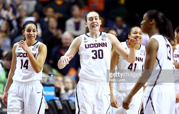 Breanna Stewart of the Connecticut Huskies smiles with teammates late in the game against the Stanford Cardinal during the NCAA Women's Final Four...