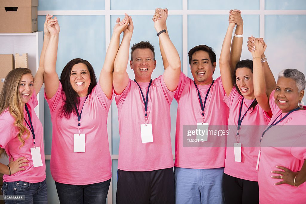 Breast Cancer Awareness volunteers show unity, collaboration. : Stock Photo