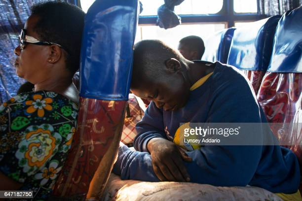 Breast Cancer patient Jessy Acen from Gulu rides the bus back to her family in Pece Vanguard on the outskirts of Gulu in between Chemotherapy...