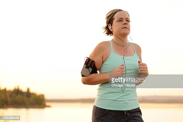 Breast cancer survivor Jennifer McCrea runs along the Glenmore Reservoir September 19 in Calgary AB Canada McCrea started running two weeks after a...