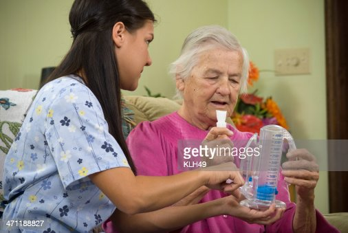 Breathing test of senior man by a nurse for a lung condition