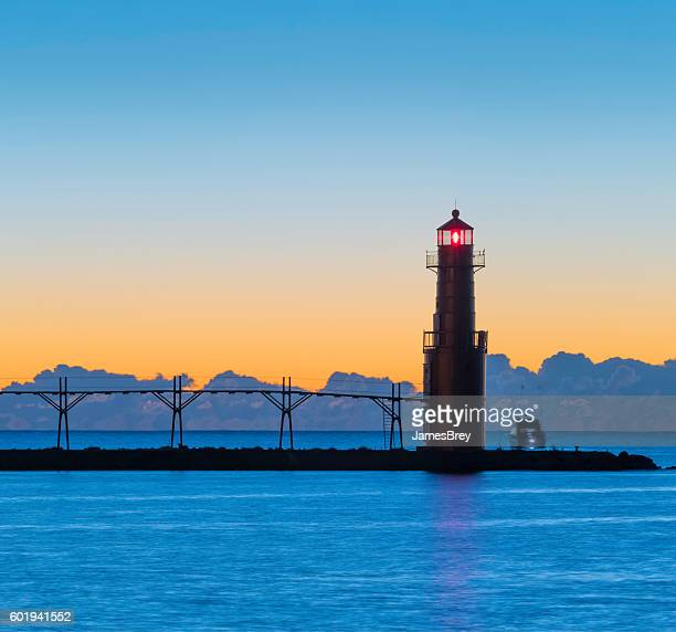 Breathtaking predawn harbor and lighthouse