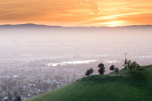 Santa Clara Valley in Haze with green hill and sunset skies from Mount Hamilton.