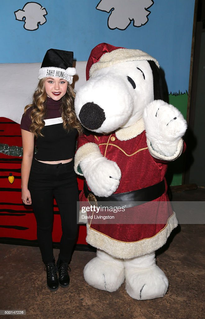 Brec Bassinger and Snoopy attend Knott's Berry Farm's Countdown To Christmas And Snoopy's Merriest Tree Lighting at Knott's Berry Farm on December 5...