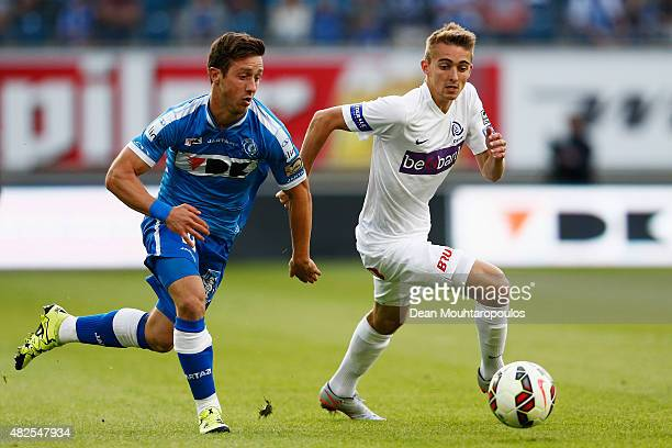 Brecht Dejaegere of Gent battles for the ball with Timothy Castagne of Genk during the Jupiler League match between KAA Gent and KRC Genk held at the...