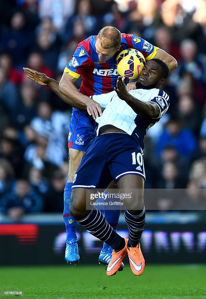 Brede Hangeland of Crystal Palace climbs above Victor Anichebe of West Brom during the Barclays Premier League match between West Bromwich Albion and Crystal Palace at The Hawthorns on October 25, 2014 in West Bromwich, England.