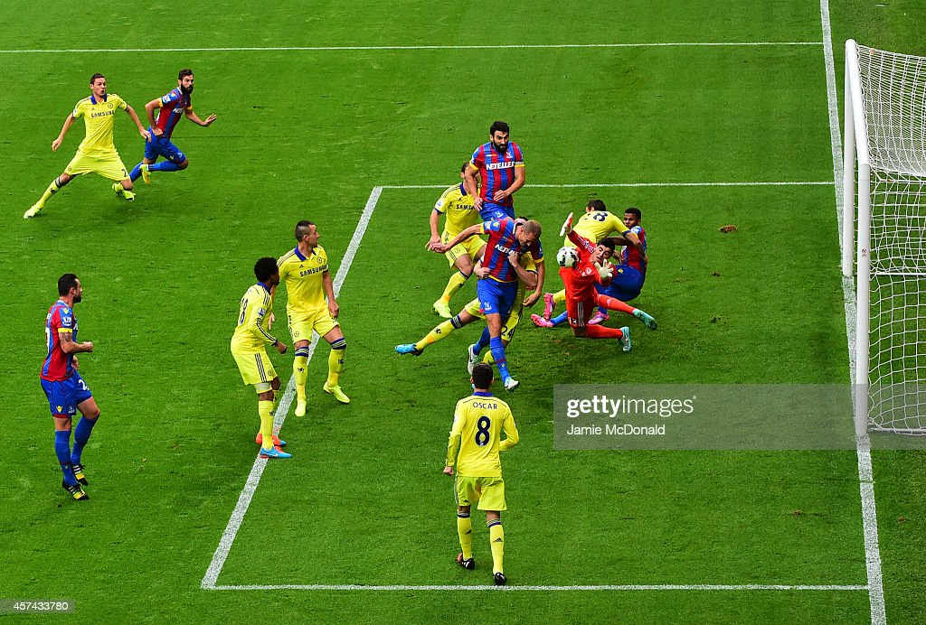 Brede Hangeland of Crystal Palace is blocked by Thibaut Courtois of Chelsea during the Barclays Premier League match between Crystal Palace and Chelsea at Selhurst Park on October 18, 2014 in London, England.
