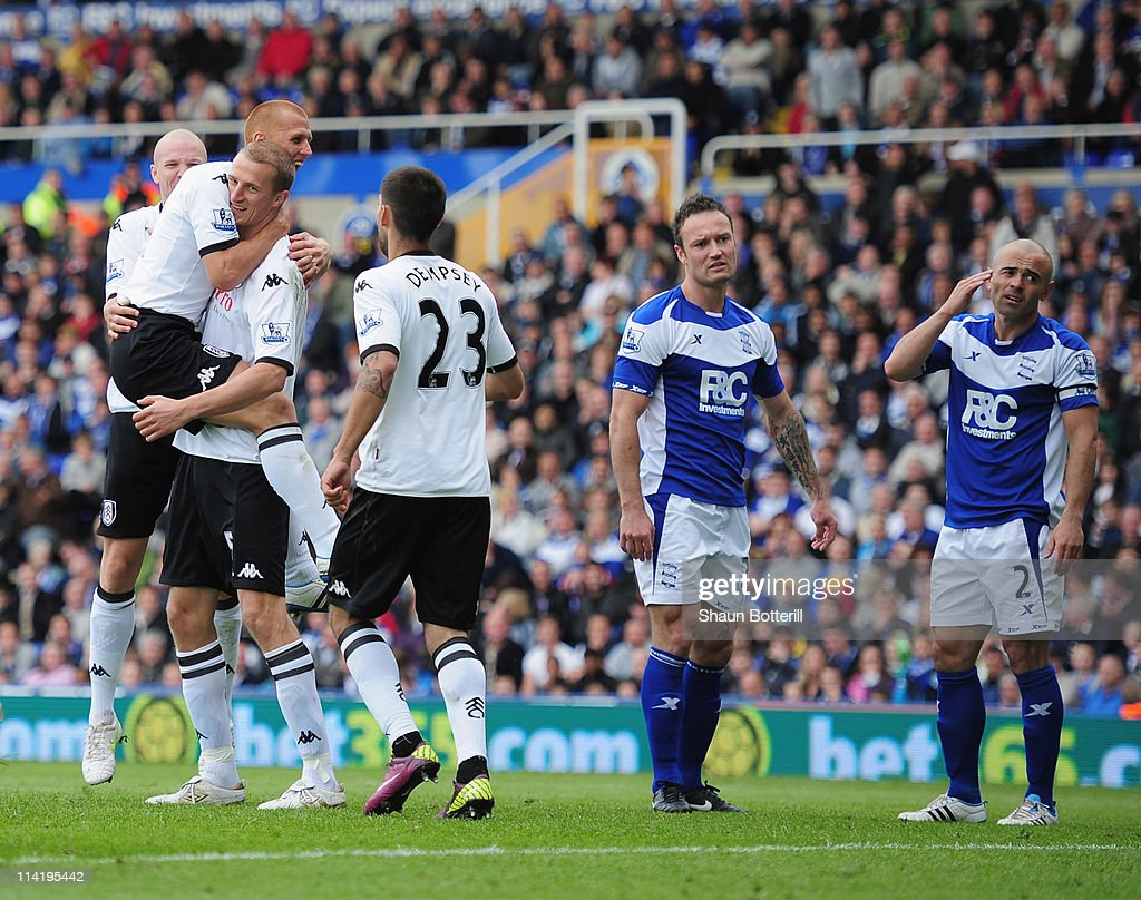 <a gi-track='captionPersonalityLinkClicked' href=/galleries/search?phrase=Brede+Hangeland&family=editorial&specificpeople=618174 ng-click='$event.stopPropagation()'>Brede Hangeland</a> of Fulham celebrates with team-mates after scoring during the Barclays Premier League match between Birmingham City and Fulham at St. Andrews on May 15, 2011 in Birmingham, England.