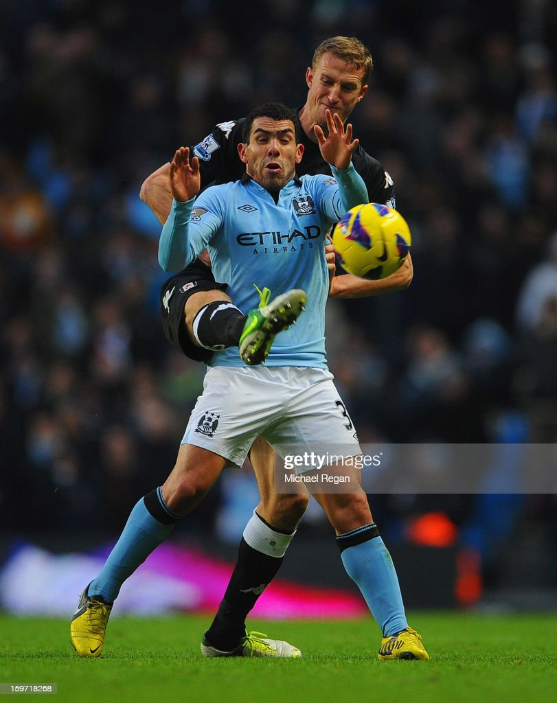 <a gi-track='captionPersonalityLinkClicked' href=/galleries/search?phrase=Brede+Hangeland&family=editorial&specificpeople=618174 ng-click='$event.stopPropagation()'>Brede Hangeland</a> of Fulham in action with Carlos Tevez of Man City during the Barlcays Premier League match between Manchester City and Fulham at the Etihad Stadium on January 19, 2013 in Manchester, England.