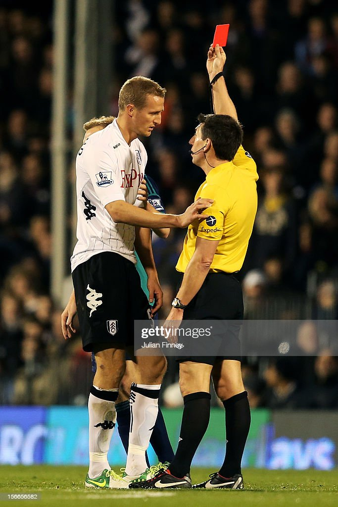 <a gi-track='captionPersonalityLinkClicked' href=/galleries/search?phrase=Brede+Hangeland&family=editorial&specificpeople=618174 ng-click='$event.stopPropagation()'>Brede Hangeland</a> of Fulham is shown a straight red card by Referee Lee Probert following a dangerous tackle during the Barclays Premier League match between Fulham FC and Sunderland AFC at Craven Cottage on November 18, 2012 in London, England.