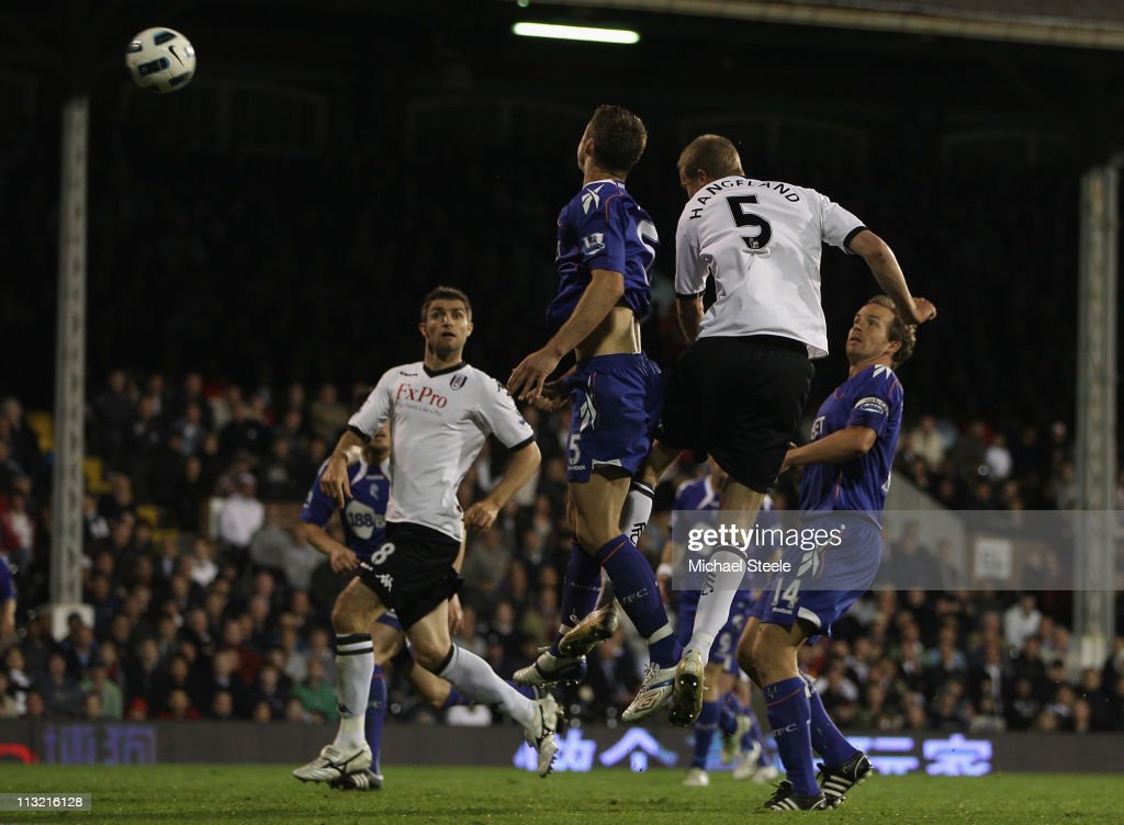 <a gi-track='captionPersonalityLinkClicked' href=/galleries/search?phrase=Brede+Hangeland&family=editorial&specificpeople=618174 ng-click='$event.stopPropagation()'>Brede Hangeland</a> (#5) of Fulham rises above <a gi-track='captionPersonalityLinkClicked' href=/galleries/search?phrase=Gary+Cahill&family=editorial&specificpeople=204341 ng-click='$event.stopPropagation()'>Gary Cahill</a> (L) to score his sides third goal during the Barclays Premier League match between Fulham and Bolton Wanderers at Craven Cottage on April 27, 2011 in London, England.