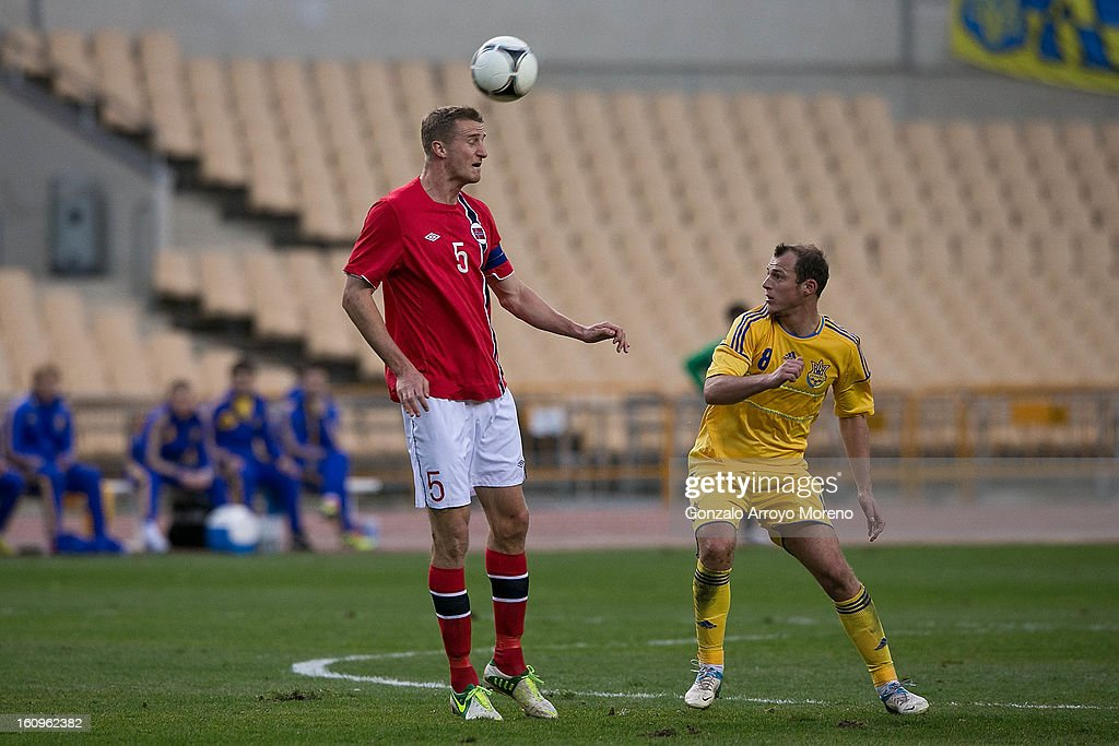 <a gi-track='captionPersonalityLinkClicked' href=/galleries/search?phrase=Brede+Hangeland&family=editorial&specificpeople=618174 ng-click='$event.stopPropagation()'>Brede Hangeland</a> (L) of Norway controls the ball as Oleh Husyev (R) of Ukraine looks on during the international friendly football match between Norway and Ukraine at Estadio Olimpico de Sevilla on February 6, 2013 in Seville, Spain.