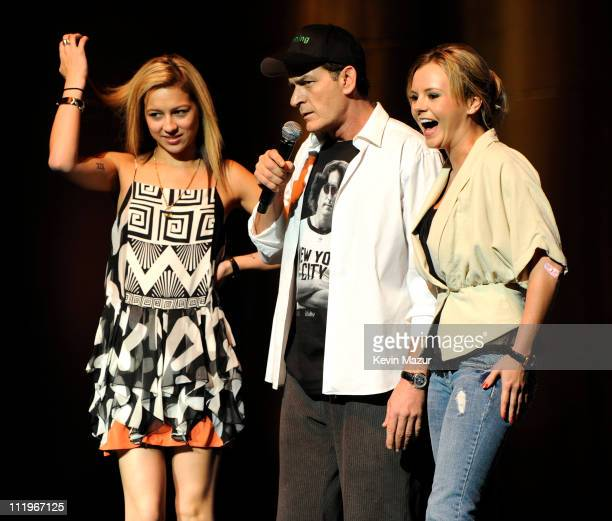 Bree Olson and Natalie Kenly stand on stage during Charlie Sheen's 'Violent Torpedo of Truth/Defeat Is Not An Option' tour at Radio City Music Hall...