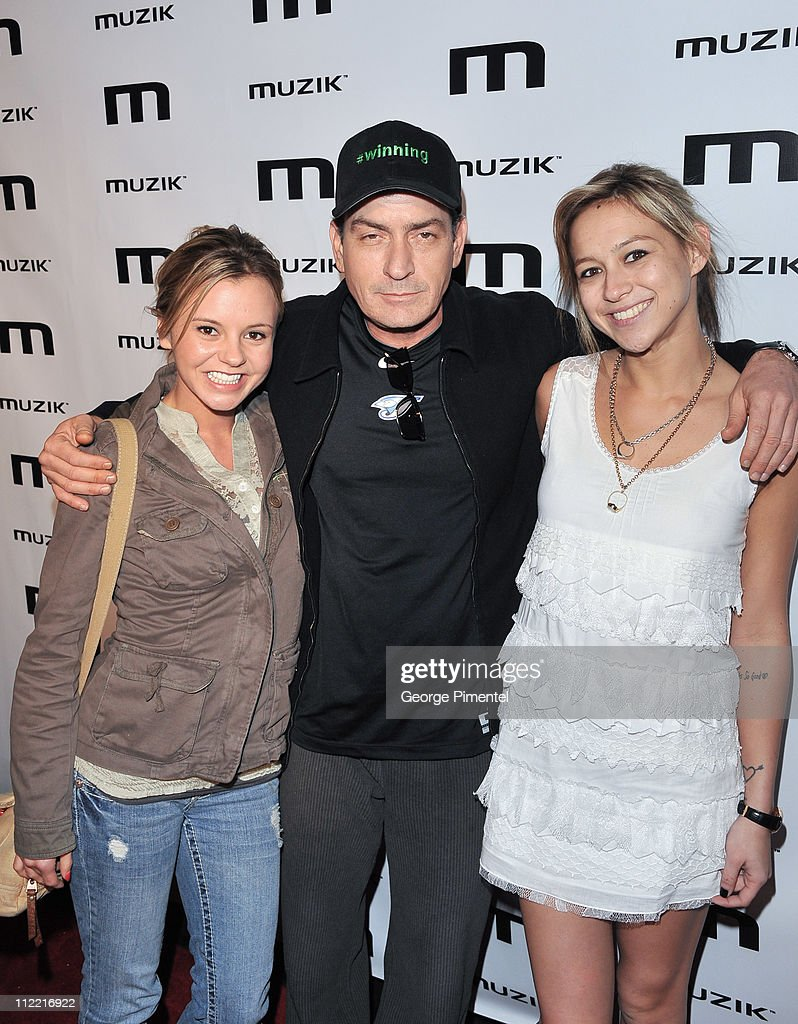 Bree Olson, Charlie Sheen and Natalie Kenly attend the official after-party for his 'Torpedo of Truth' tour at Muzik on April 14, 2011 in Toronto, Canada.