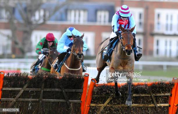 Breedsbreeze and Ruby Walsh jump the last to win The Anglo Irish Bank Tolworth Hurdle from Deep Purple and Paul Moloney at Sandown Park Racecourse...