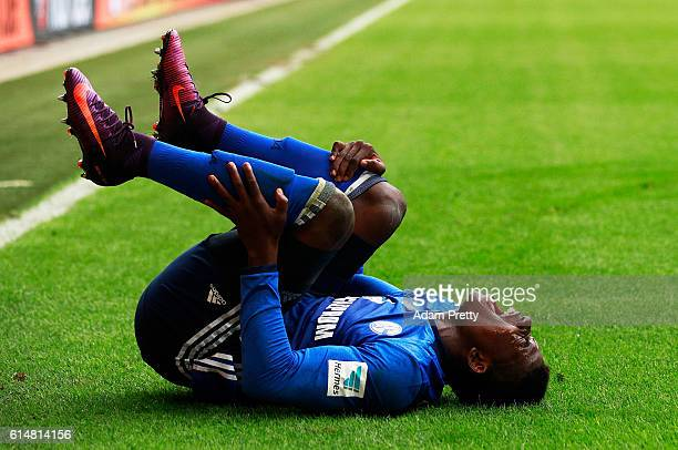 Breel Donald Embolo of Schalke 04 is injured by Kostas Stafylidis of Augsburg during the Bundesliga match between FC Augsburg and FC Schalke 04 at...