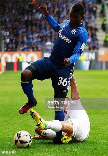 Breel Donald Embolo of Schalke 04 is injured by Kostas Stafylidis of Augsburg during the Bundesliga match between FC Augsburg and FC Schalke 04 at...