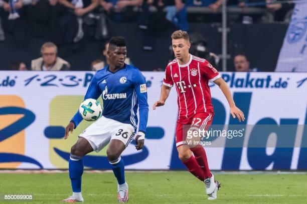 Breel Embolo of FC Schalke 04 Joshua Kimmich of FC Bayern Munich during the Bundesliga match between Schalke 04 and Bayern Munich on September 19...